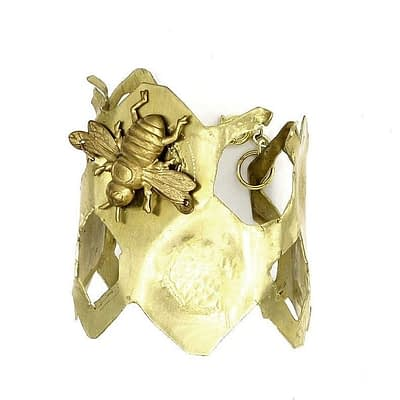 Brass cuff resembling a honey comb with brass bee.