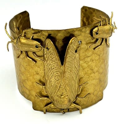 Hammered brass cuff with brass beetles and cicada.