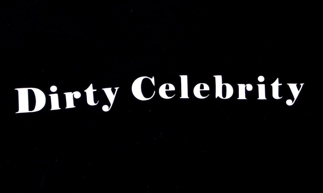"""Back of logo tee says """"Dirty Celebrity""""."""