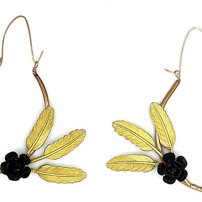 Hoop earrings with brass leaves and black aluminum roses.