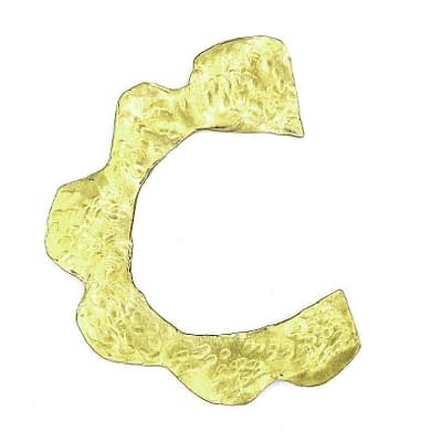Brass ear cuff shaped like a daisy