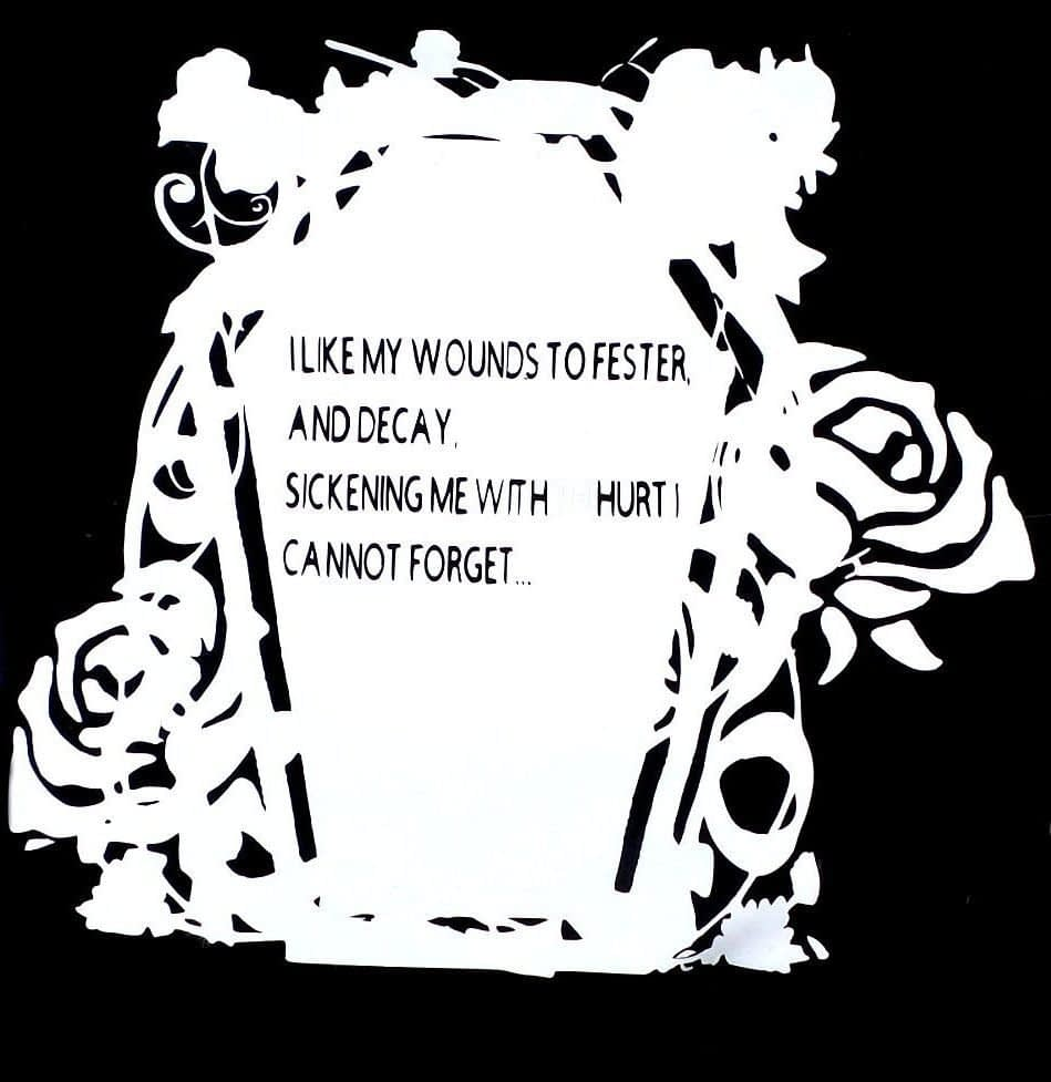"""Coffin graphic with roses surrounding it and words """"I like my wounds to fester and decay, sickening me with hurt I cannot forget"""" on coffin lid."""