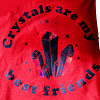 Closeup of red tank top with adjustable straps with words crystals are my best friends. Graphic of crystals with holographic accents.