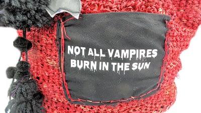 Closeup of pocket for vampire theme beach tote