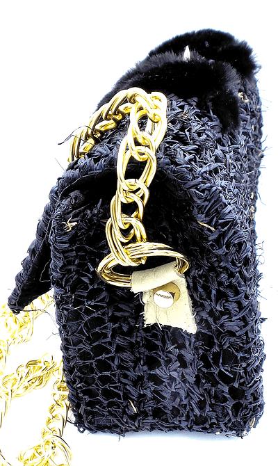 black spike bag side