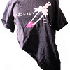 """Black tee cut at angle with kanji words """"cute kills"""" and knife with bow in middle with pink blood."""