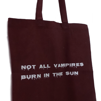 """Blood red beach tote bag with words """"not all vampires burn in the sun."""